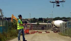 Drone Operator Flying A Drone Over A Construction Site